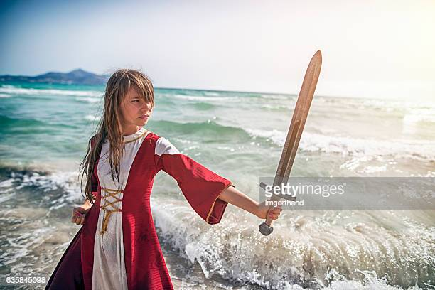 Young viking shieldmaiden practicing with sword