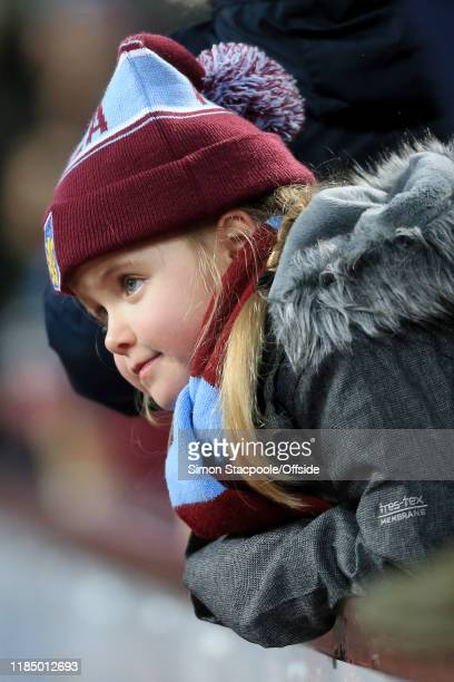 A young Villa fan looks on during the Premier League match between Aston Villa and Newcastle United at Villa Park on November 25 2019 in Birmingham...