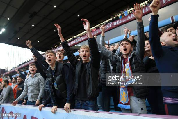 Young Villa fans cheer their side on during the Premier League match between Aston Villa and Brighton Hove Albion at Villa Park on October 19 2019 in...