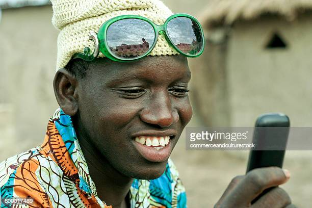 Young villager enjoying with a mobile phone