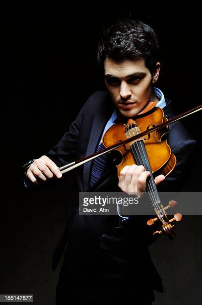 young violinist - violin family stock photos and pictures