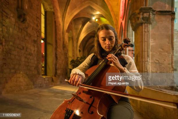 young violoncellist playing - cellist stock pictures, royalty-free photos & images