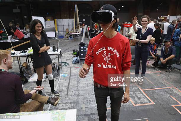 A young visitor explores a Virtual Reality landscape with VR goggles at the 2016 Berlin Maker Faire on October 1 2016 in Berlin Germany The Maker...