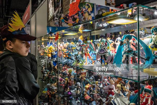 A young visitor is seen while observing a display cabinet with reproductions of comic characters The 36th Barcelona International Comic Fair from...