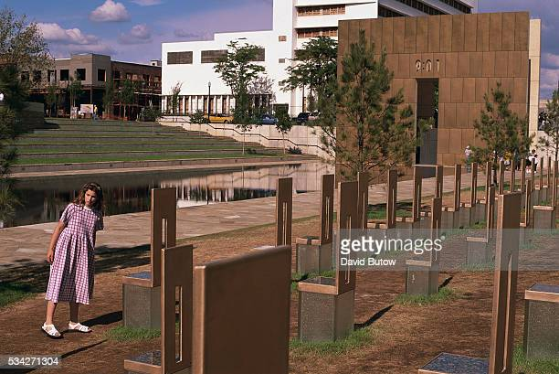 A young visitor to the Oklahoma City National Memorial walks among empty chairs that signify those lost in the Oklahoma City bombing On April 19...
