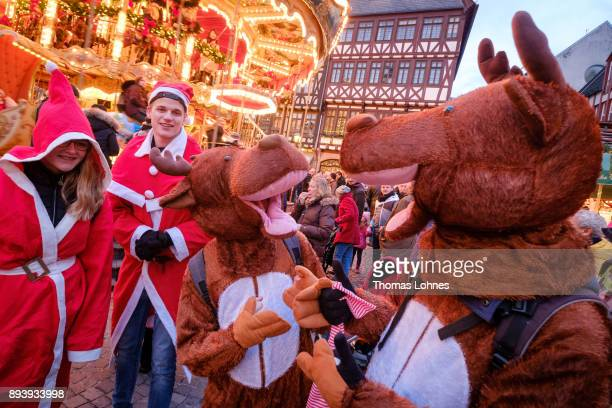 Young visitors dressed in reindeer and Santa Claus suits have fun at the annual Christmas market at Roemerberg on December 14 2017 in Frankfurt...