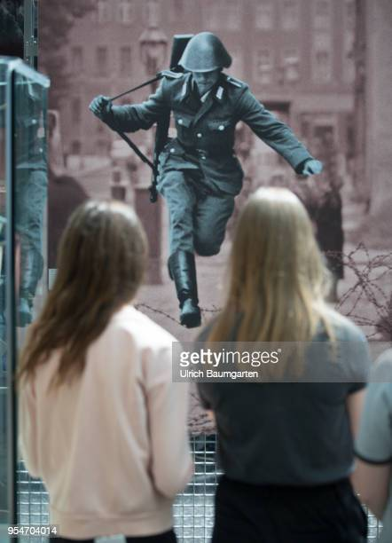 Young visitors of the Museum of History of the Federal Republic of Germany in front of one of the most famous photos of the Cold War Conrad Schumann...