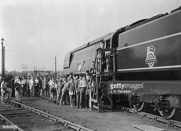 Young visitors queuing up to stand on the footplate of a new Battle of Britain Class locomotive the Sir Eustace Missenden during an open day at a...