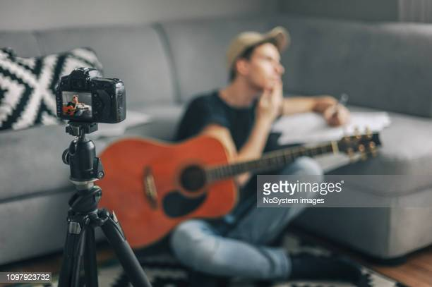 young vlogger, guitarist filming his vlogg - vlogging stock pictures, royalty-free photos & images