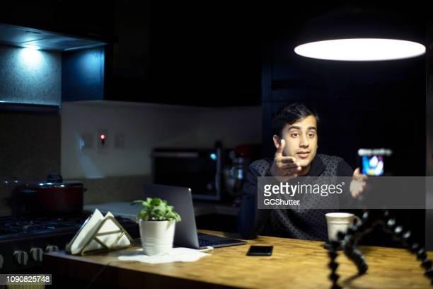 Young Vlogger Recording his Next Vlog at the Kitchen