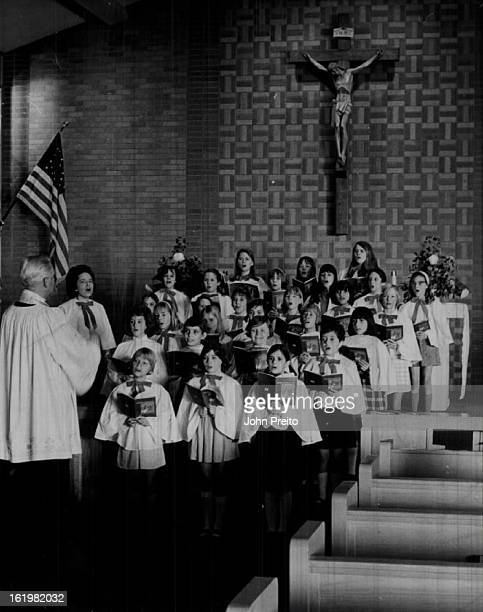 Young Voices in Notre Dame Church Choir join in Christmas songs;