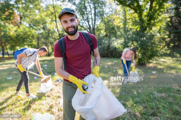 young volunteer looking at camera - ecologist stock pictures, royalty-free photos & images