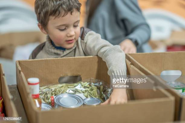 young volunteer - famine stock pictures, royalty-free photos & images