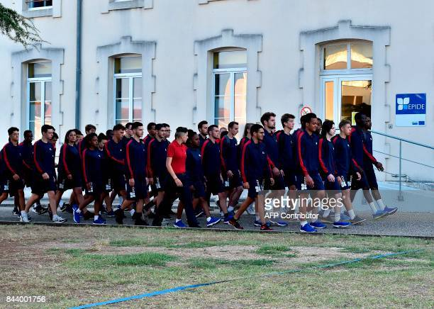 Young volunteers walk in the courtyard of a former military barracks in Bordeaux on September 1 as part of the programme for integration in...