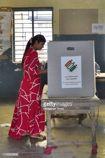 A young voter casts her her vote at a polling booth in Model town on May 12 2019 in New Delhi India Voting began for the 59 seats in the 6th phase of...