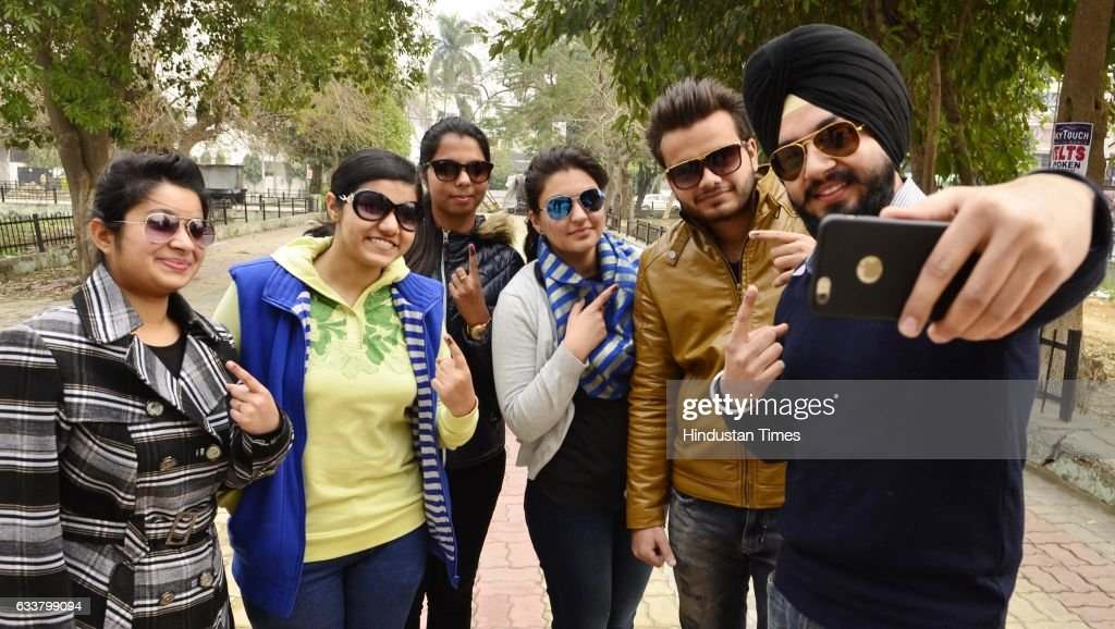Young voters in Amritsar clicking a selfie after casting their votes on Punjab Poll Day on February 4 2017 in Amritsar India Punjab on Saturday voted.