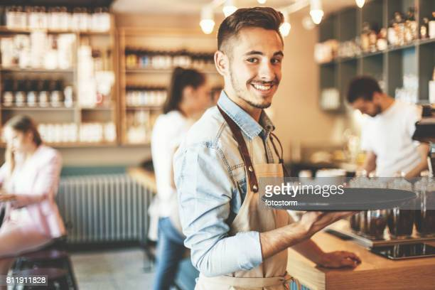 young waiter serving - wait staff stock pictures, royalty-free photos & images