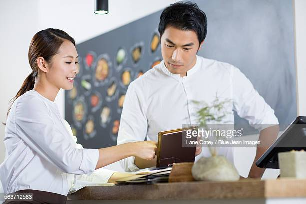 Young waitress and cashier