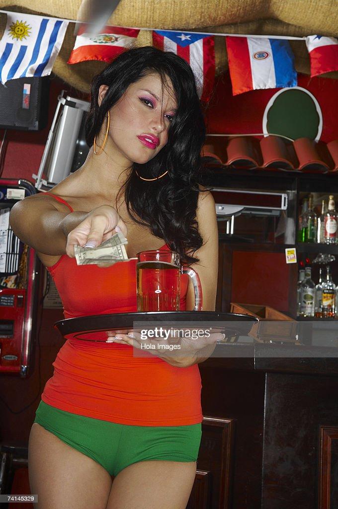 Young waitress giving change