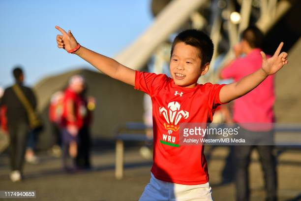 A young Wales fan outside the stadium before the Rugby World Cup 2019 Group D game between Wales and Fiji at Oita Stadium on October 9 2019 in Oita...