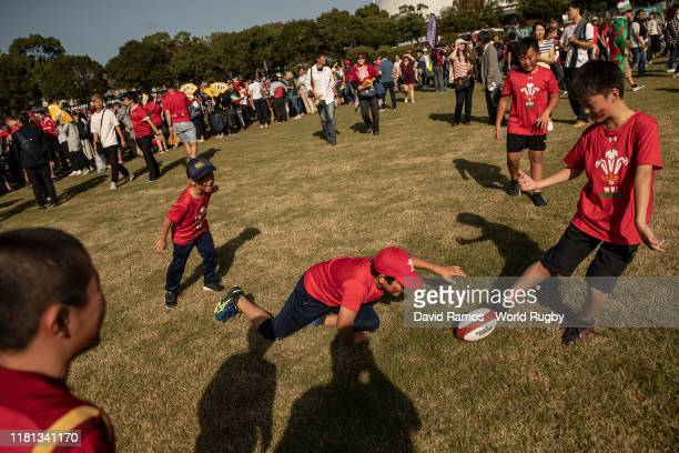 Young Wales fans play rugby outside the stadium prior to the Rugby World Cup 2019 Group D game between Wales and Uruguay at Kumamoto Stadium on...