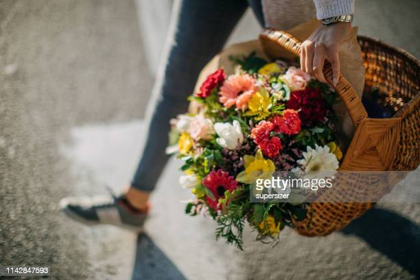 young walking city streets with flower bouquet - human foot stock pictures, royalty-free photos & images