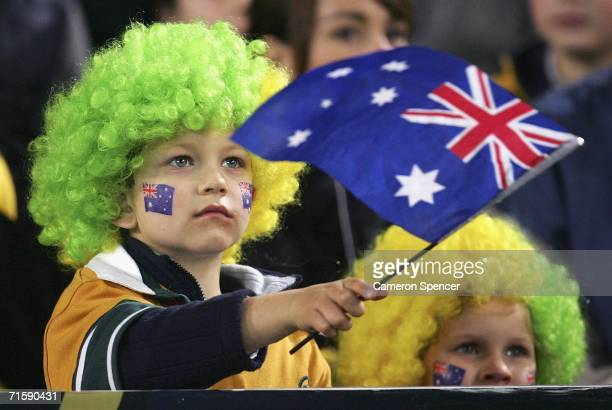 Young Wallaby supporters show their colours during the Tri Nations series second Mandela plate match between Australia and South Africa at Telstra...