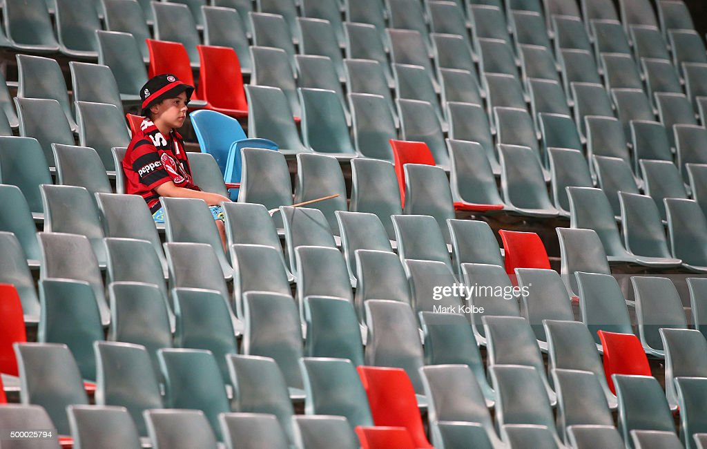 A young Wanderers supporter watches on from the empty seats in the bays usually taken up by 'Red and Black Bloc' Wanderers supporters groupduring the round nine A-League match between Sydney FC and the Newcastle Jets at Allianz Stadium on December 4, 2015 in Sydney, Australia.