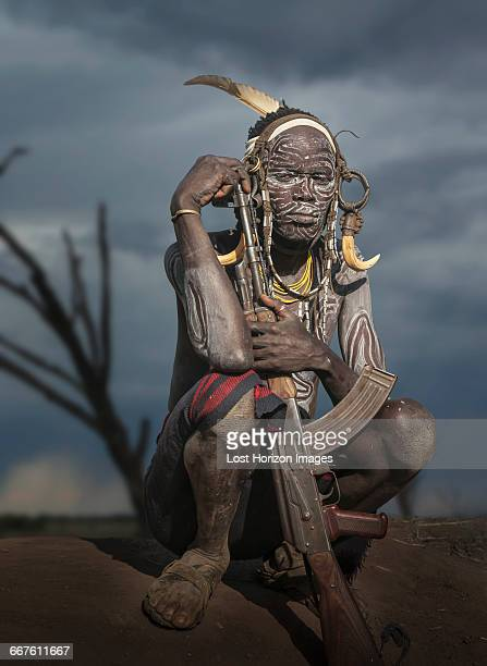 Young warrior of the Mursi tribe with Kalashnikov gun, Omo Valley, Ethiopia
