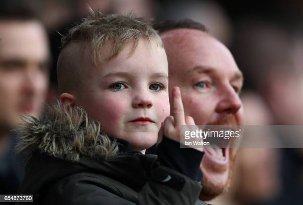 A young Watford fan gestures during the Premier League match between Crystal Palace and Watford at Selhurst Park on March 18 2017 in London England