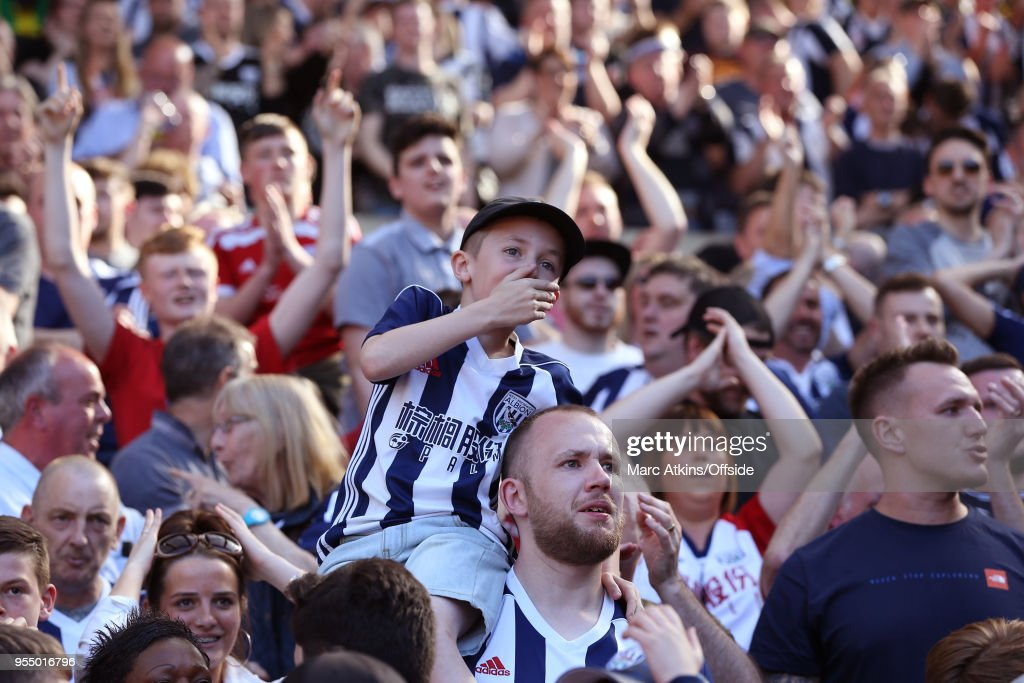 A young West Brom fan reacts during the Premier League match between West Bromwich Albion and Tottenham Hotspur at The Hawthorns on May 5, 2018 in West Bromwich, England.
