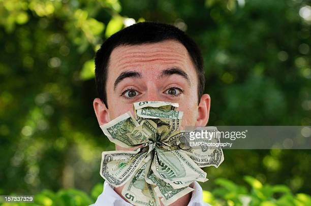 Young White Man With Wad of Money in his Mouth