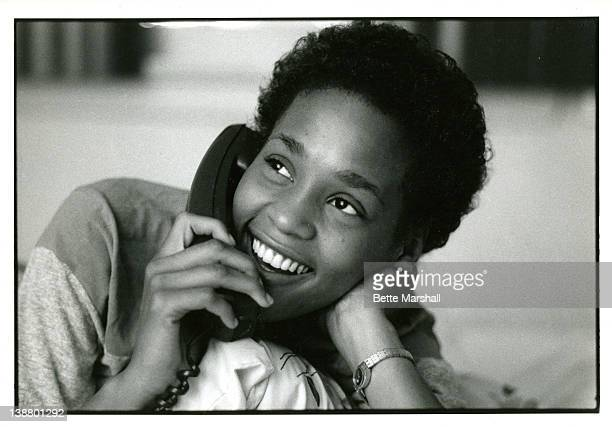 A Young Whitney Houston is pictured on the telephone in her bedroom circa 1982 in West Orange New Jersey