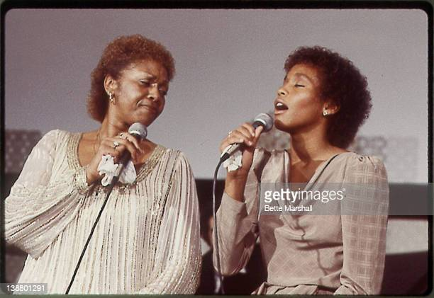 A Young Whitney Houston performs with her mother Cissy Houston circa 1982 at New Hope Baptist Church in Newark New Jersey
