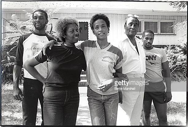 A Young Whitney Houston poses with her mother Cissy Houston father John Houston brother Michael Houston and half brother Gary Garland outside their...