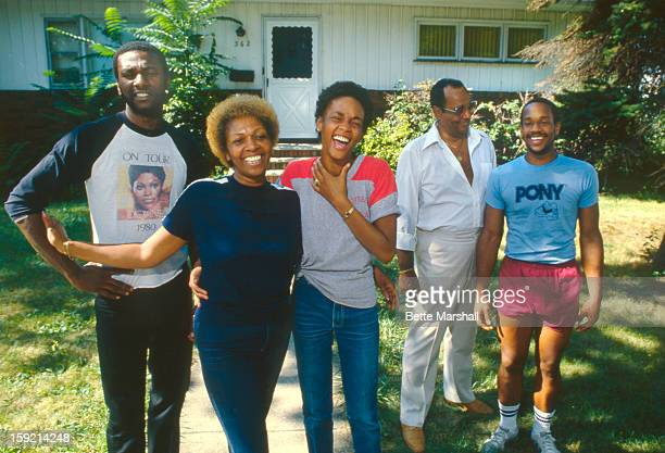 A Young Whitney Houston poses with her mother Cissy Houston father John Houston brother Michael Houston and half brother Gary Garland circa 1982 in...