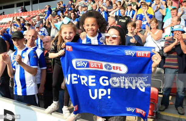 Young Wigan Athletic fans in the stands show their support