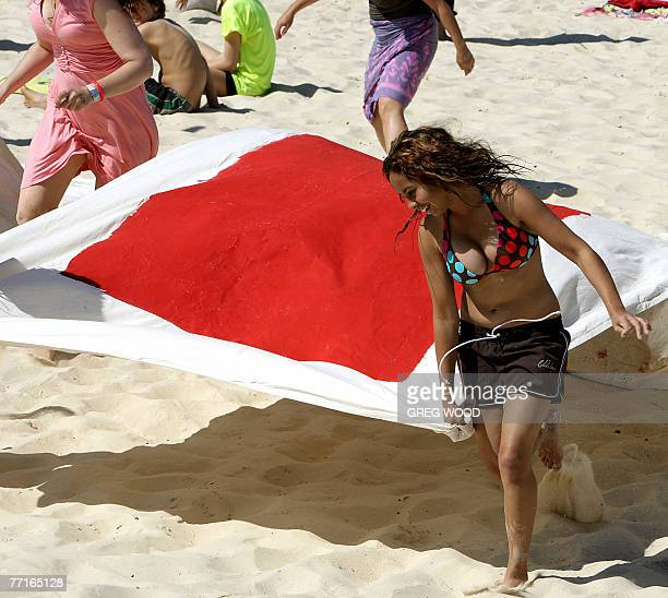 A young Wilderness Society member helps lay out giant letters on Sydney's Bondi Beach 03 October 2007 asking the federal government to stop the...