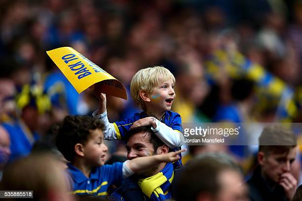 A young Wimbledon fan looks on during the Sky Bet League Two Play Off Final match between Plymouth Argyle and AFC Wimbledon at Wembley Stadium on May...