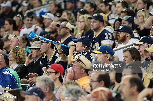 Young Winnipeg Blue Bombers' fan blows a horn during game action in a CFL game against the Ottawa RedBlacks at Investors Group Field on July 3, 2014...