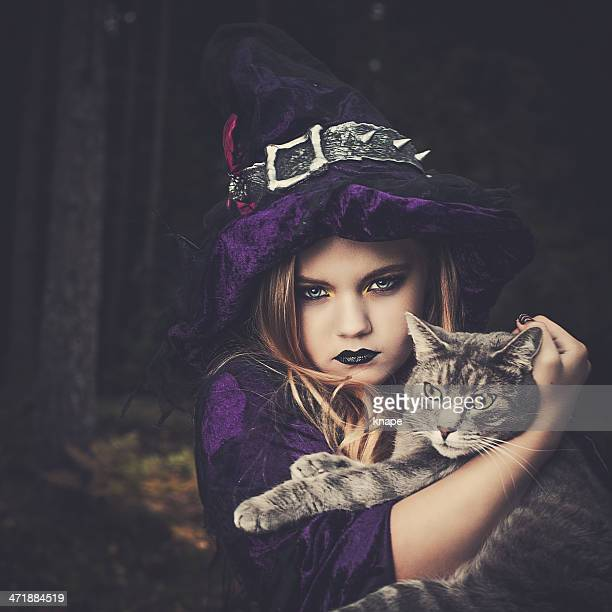 Young witch with cat