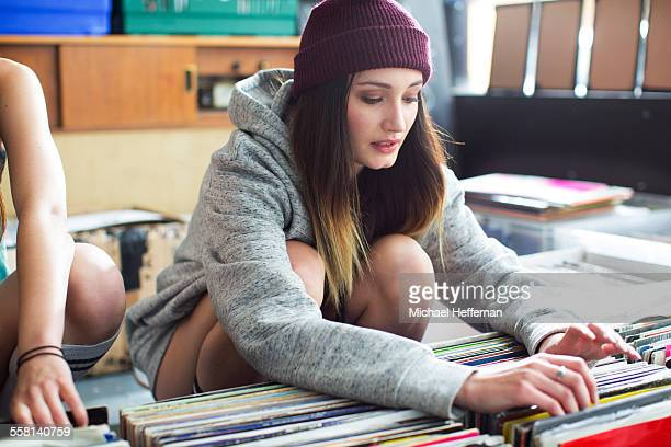 Young woamn looking at records in store