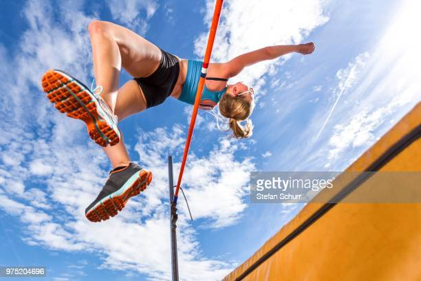 Young woman, 18 years, high jump