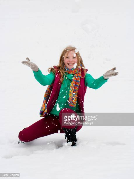 Young woman, 20 years, in winter clothes in snow