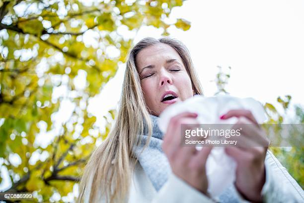 Young woman about to sneeze