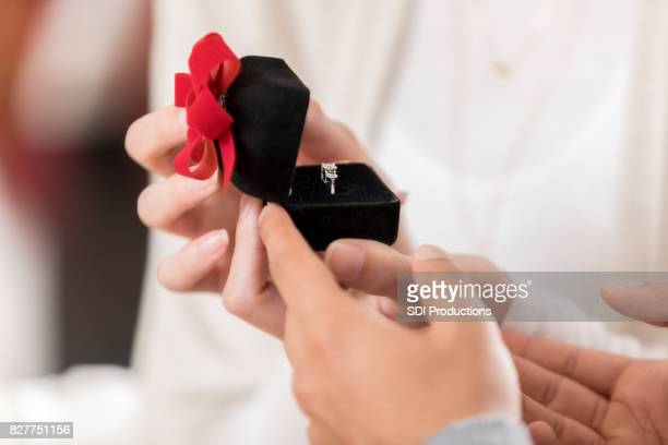 young woman accepts boyfriend's marriage proposal - engagement ring box stock photos and pictures