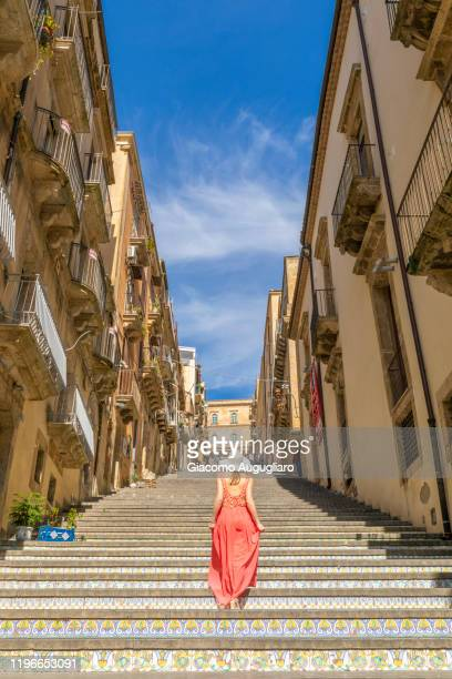 young woman admiring the staircase of caltagirone, catania province, sicily, italy - カターニア ストックフォトと画像