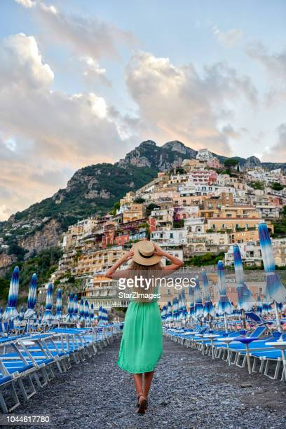 Young woman admiring the view of Positano village on Amalfi coast