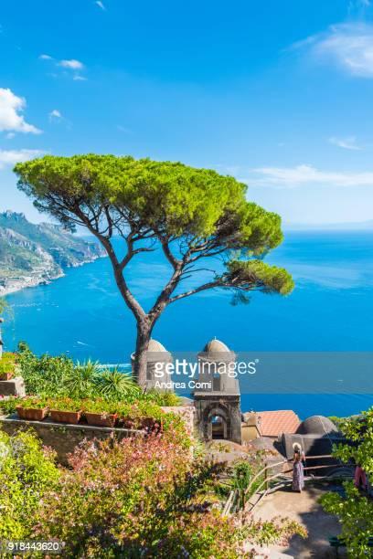 a young woman admiring the view. ravello, amalfi coast, salerno, campania, italy - amalfi coast stock photos and pictures