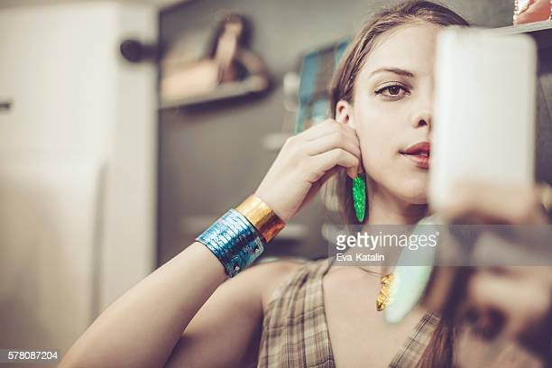 young woman advertising jewelry - ohrring stock-fotos und bilder